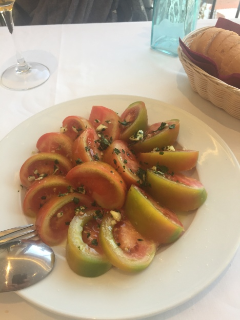 picture of tomatoes cut and placed on a plate